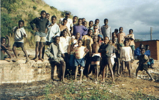In the bad lands with the village kids, I'm the white guy!