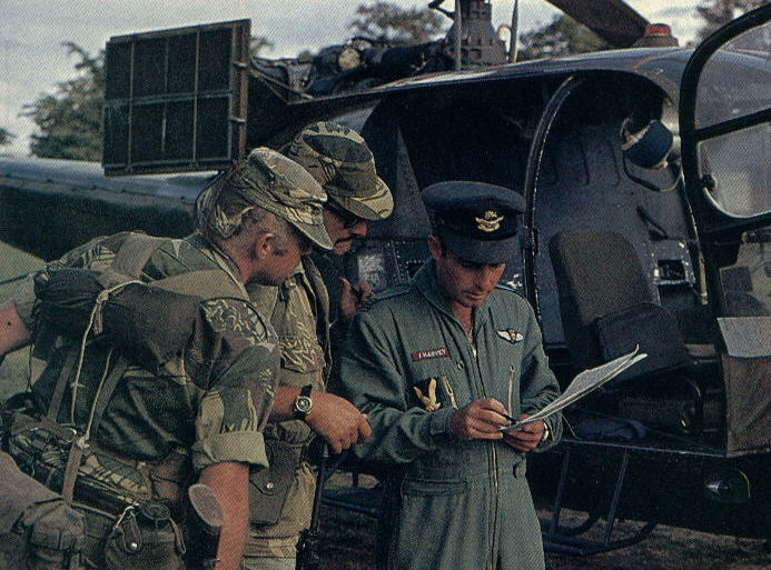 Scouts discuss dropoff points with Gazelle pilot prior to takeoff.