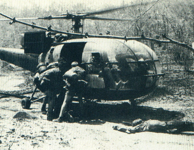 Selous Scouts lift rebel dead aboard a waiting helo after a ambush.