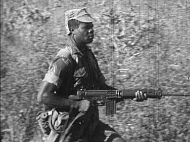 Selous Scout on the move with FN FAL in hand.