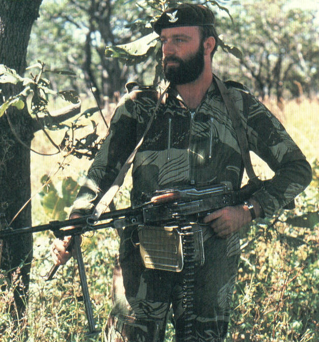 Selous Scout with Russian light machine gun. Note camouflage and beard.