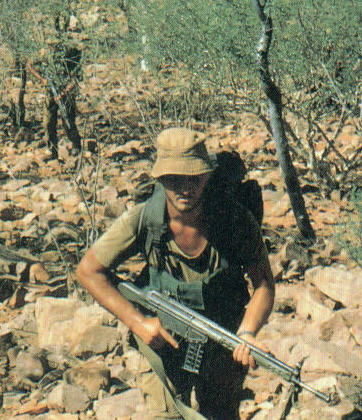Scout trailing spoor in the Rhodesian bush.